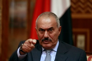 File photo of Yemen's President Ali Abdullah Saleh pointing during an interview in Sanaa