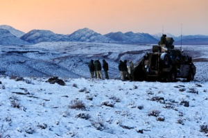 Caption. While Australia swelters in summer heat, soldiers from Australia's Special Operations Task Group (SOTG) in Afghanistan make the most of a winter wonderland.  Mid caption: SOTG Reaches Out to Remote Communities in Oruzgan Patrolling among the isolated village communities in the mountains of Oruzgan Australia's Special Operations Task Group (SOTG) is continuing to establish new and important bonds with the people.  With the onset of winter, the insurgents' influence is still evident, requiring constant vigilance and focus from soldiers of Australia's SOTG. Working with their partner unit, the Provincial Police Reserve (PPR), they are spending the winter pushing out to remote villages and snowy mountain valleys to engage with Afghans, providing them confidence in their Governments growing ability to provide for their basic needs such as medical, health and security requirements. This continues the SOTG's population centric approach adopted in recent times in line with Commander ISAF's intent. Although only relatively short distances from Tarin Kowt as the crow flies, the mountain valleys cradling the communities of Garmab and Patan are over watched by 2000 metre mountainsides and only accessible by unreliable vehicle tracks. After crossing some difficult terrain by vehicle the SOTG and the PPR went in to both valleys on foot. Before their recent visits, Coalition forces had not visited these areas for years. An important aspect of the visits was to assess community standards of health and access to medical care and to understand their social and security structures. Each small village is unique. far removed from town water and electricity these villages exist apart from some of the simple staples enjoyed by Oruzgan's larger population centres. Despite the fact they had no ready access to health facilities, the SOTG Medical Officer, Major G, said the people of the valleys were in relatively good health. When he visited Garmab,